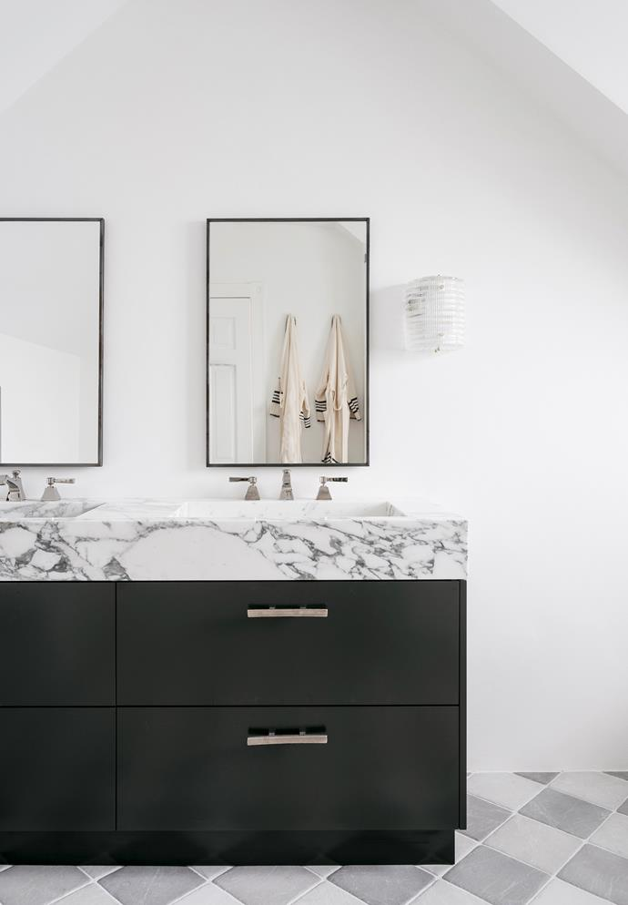 Interior architect Phoebe Nicol was engaged to refresh this home in Sydney. Much like the rest of the interiors, the bathroom boasts a classic appeal with a contemporary edge. Perrin & Rowe tapware from the English Tapware Company, and a vanity topped with Calcatta marble from Artdemous. *Photograph*: Felix Forest. From *Belle* May 2019.