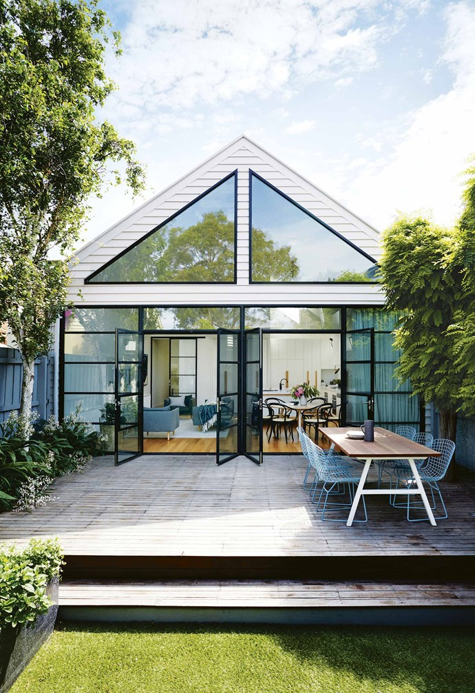 "When Todd and Rachael bought the Port Melbourne property in 2006, they knew it had potential. A freestanding Victorian-era house with a more recent extension at the back, it had a [pretty facade](https://www.homestolove.com.au/fabulous-facades-18972|target=""_blank"") and was positioned on a large corner block close to the city and the seaside. ""We're at the beach in five minutes,"" says Rachael. ""It takes about 15 minutes to walk to South Melbourne markets and we're so close to the city.""<br><br>**Exterior** Owners Rachael and Todd committed to a wall of black steel-framed windows and doors."