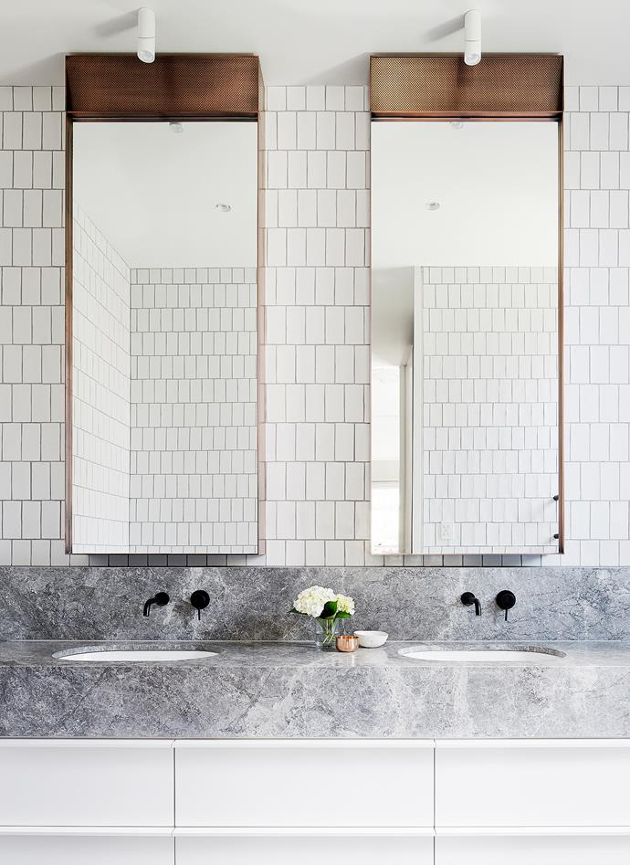 Simple brick tiles and pared back joinery sit alongside the modern luxuries in this bathroom designed by Mim Design.