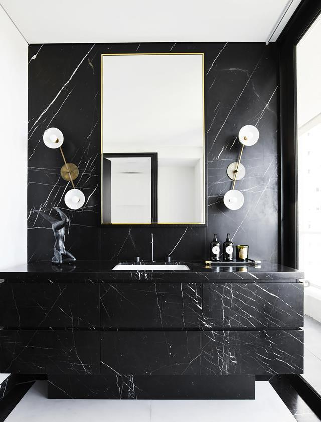 Poco Designs' Poppy and Charlotte O'Neil created a luxe, bespoke feel for this Sydney apartment. Custom vanity by Melmac Interior Joinery in marble from Nefiko Marble with Apparatus wall lights from Criteria. *Photograph*: Anson Smart. From *Belle* February/March 2019.