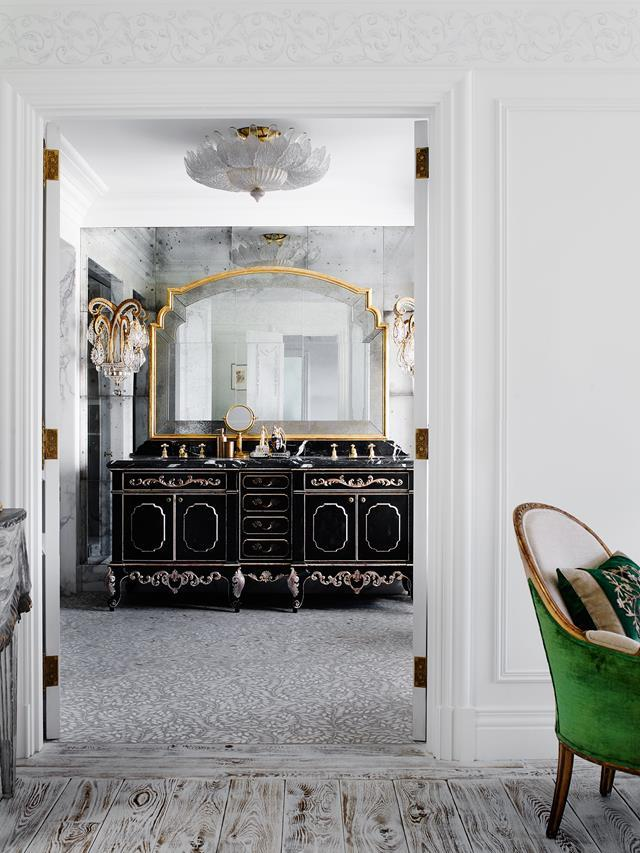 The master ensuite in this Italianate mansion designed by Dylan Farrell features a dramatic custom vanity by Adam Hart and a mirror from Dering Hall.