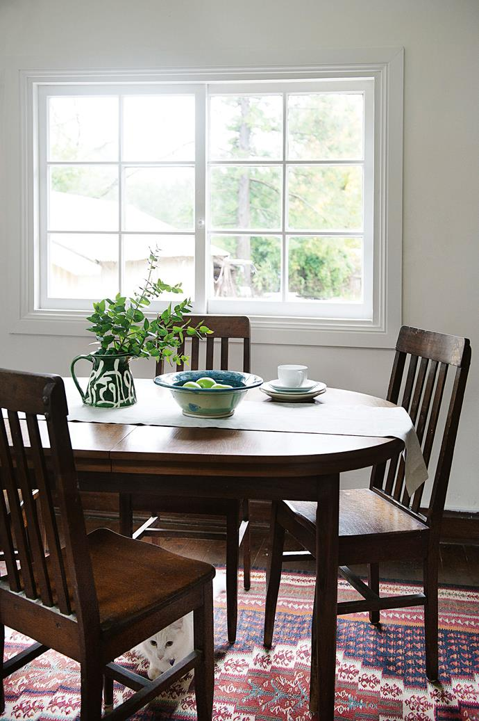 """""""There were hatboxes full of cards, paintings, award-winning needlework by Sheila's mother… But thank goodness for hoarders — they provide such a great window into history."""" The dining table was an eBay find and the kilim was purchased at a Sutton Forest village market."""