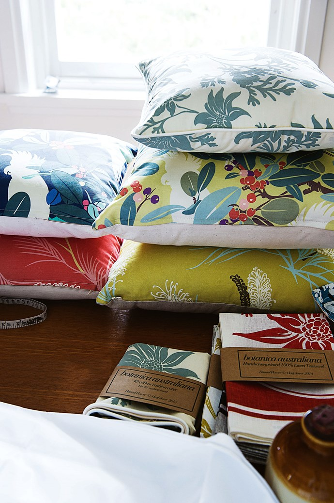 4 Leaf Clover cushion designs, clockwise from top left, 'Moreton Bay Fig & Cockatoo' in Navy, 'Flannel Flower' in Sage, 'Moreton Bay Fig & Cockatoo' in Chartreuse, 'Grevillea' in Chartreuse and in Coral.