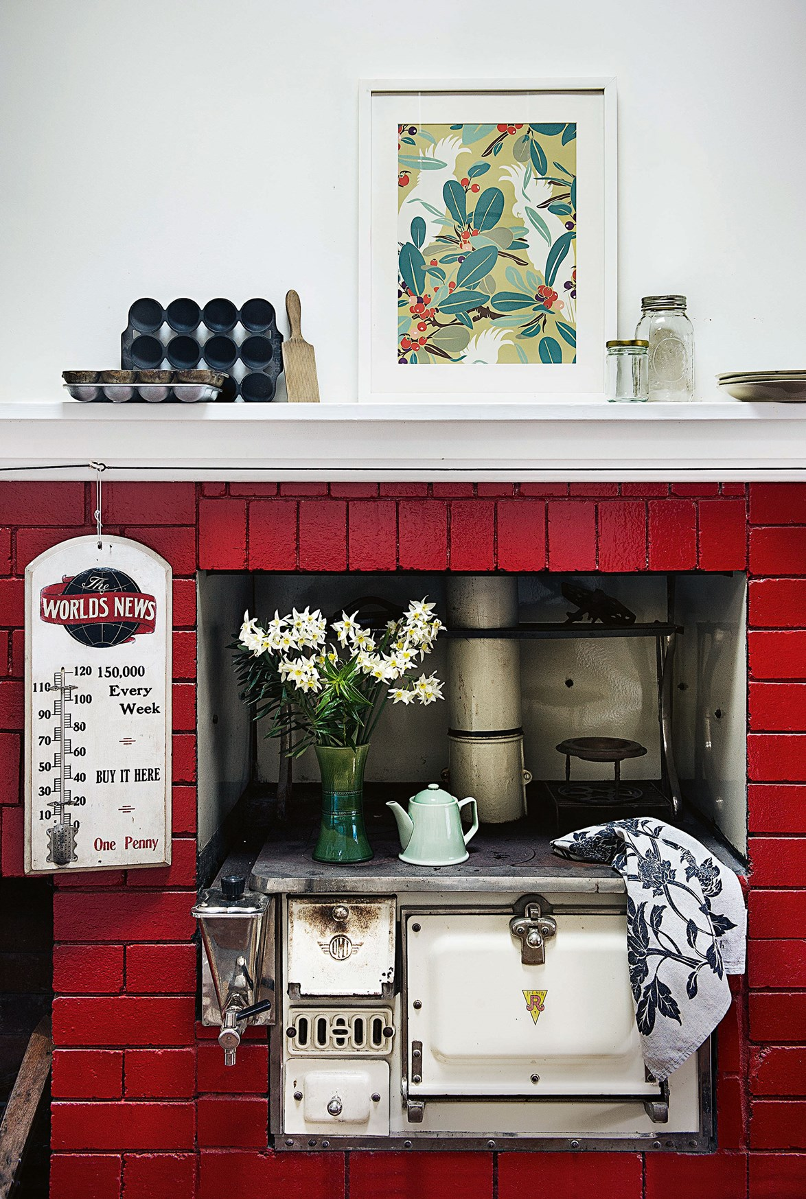 """Painted red bricks frame an antique wood-burning stove at a home in Bundanoon. The [1930s-era house](https://www.homestolove.com.au/designer-reno-of-1930s-cottage-13634