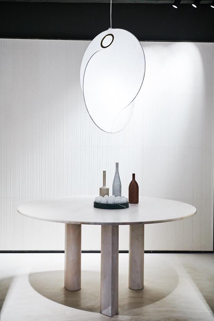 Michael Anastassiades's stone table for Salvatori with exquisite petal-like legs.