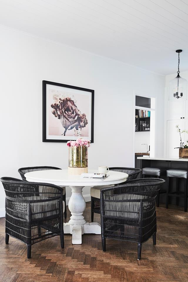 "The stylish dining room in this [Federation home](https://www.homestolove.com.au/federation-home-receives-modern-revamp-19693|target=""_blank"") features an elegant table from Orient House surrounded by Malawi cane chairs."