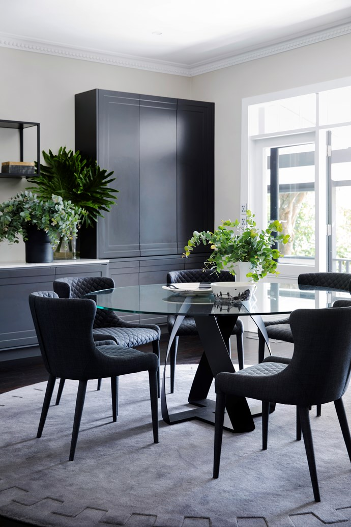 Interior designer Lynne Bradley incorporated a contemporary Protocco 'Bon Bon' black embossed dining table with a glass top from Cosh Living to this bold dining space. *Photograph*: Chris Warnes | *Styling*: Sarah Maloney