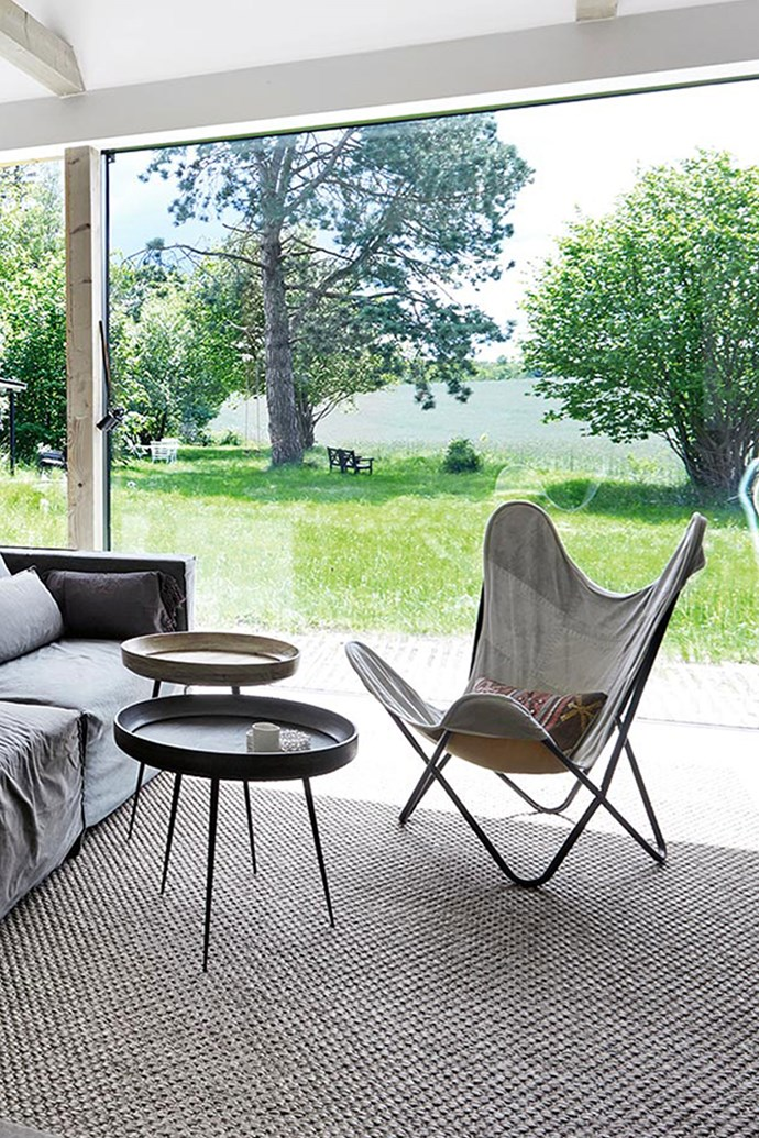"The long, narrow design of the house (architect Jakob Moller) turns its back on the highway that Hélène is happy to ignore, all windows and doors focusing on the picturesque farmland and ocean views instead. The easy chair is covered in fabric recycled from old military tents, which Hélène likes as a reflection of her [""nomad"" lifestyle](https://www.homestolove.com.au/diy-camper-van-6187