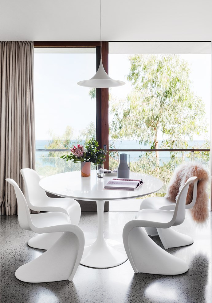 Thanks to iconic 20th-century furniture, dining in this self-contained apartment designed by Rob Mills is a highly stylish event. *Photograph*: Martina Gemmola