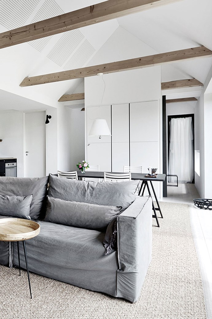 These exposed beams in the living area have been left unpainted so that they will gradually gain a silvery-grey patina and merge into the colour scheme.