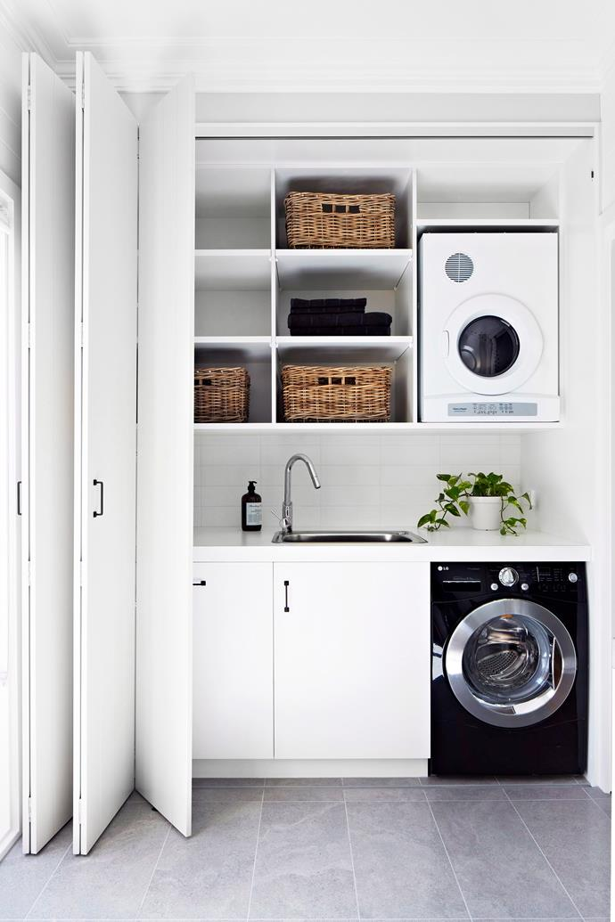 "[A practical laundry](https://www.homestolove.com.au/laundry-inspiration-gallery-17912|target=""_blank"") is clutter-free, so store supplies in baskets on shelving and leave space for hampers under benches. *Photo:* Armelle Habib"