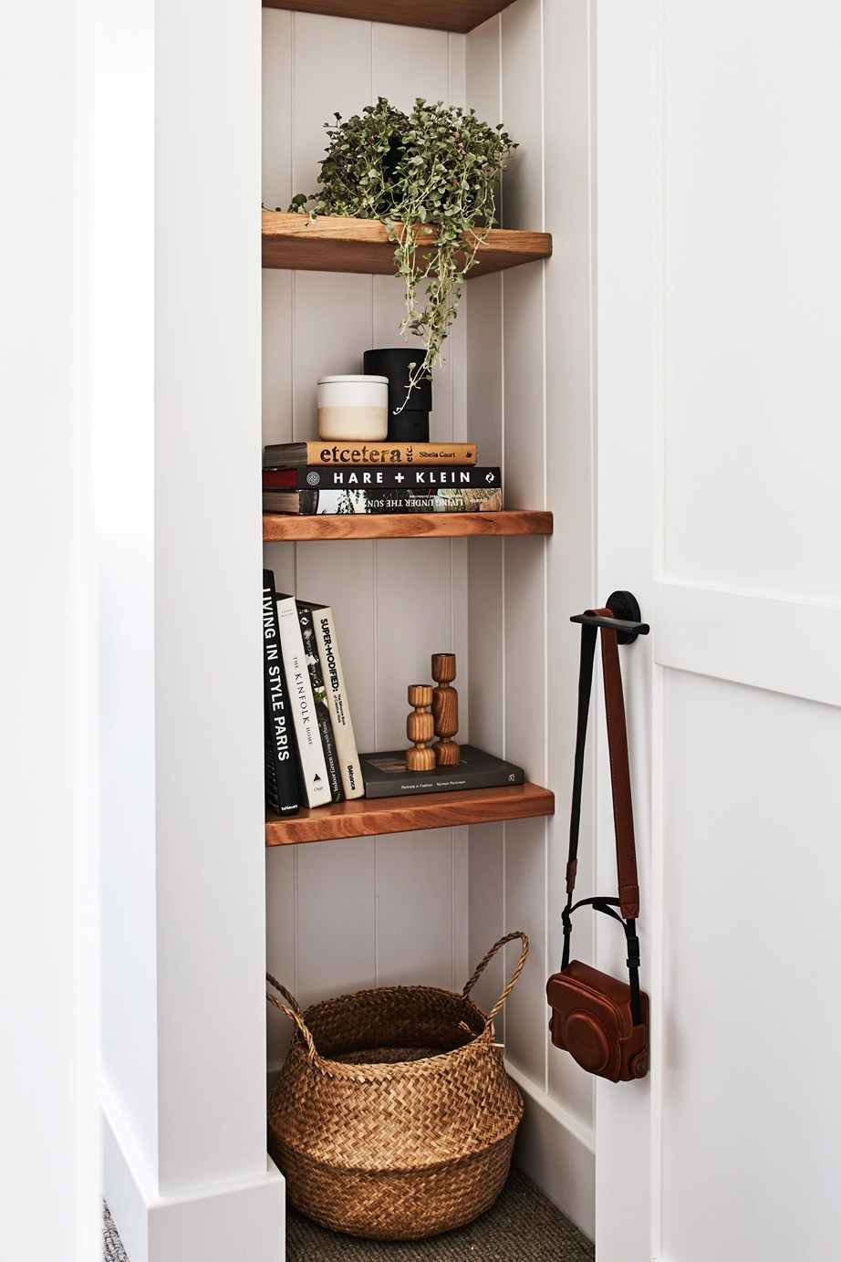 If there's no floorspace to spare, cutting into the wall to create built-in shelving will add character to a non-existent entrance, not to mention some bonus storage! Note: You will need to hire a carpenter or joiner to do this.