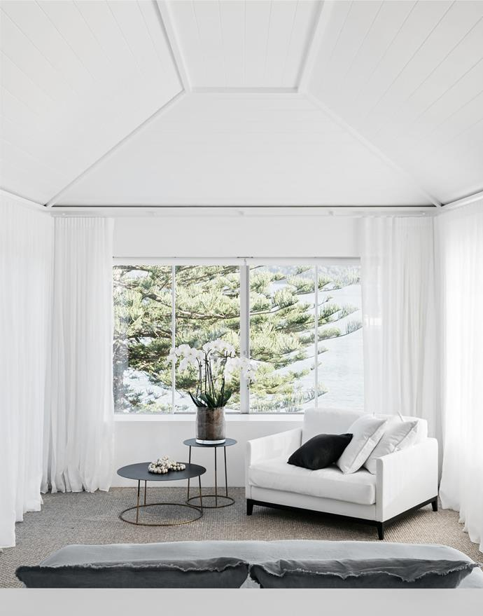 'Banjo' love seat in white linen from MCM House. 'Nimbus' side tables from Les Interieurs.
