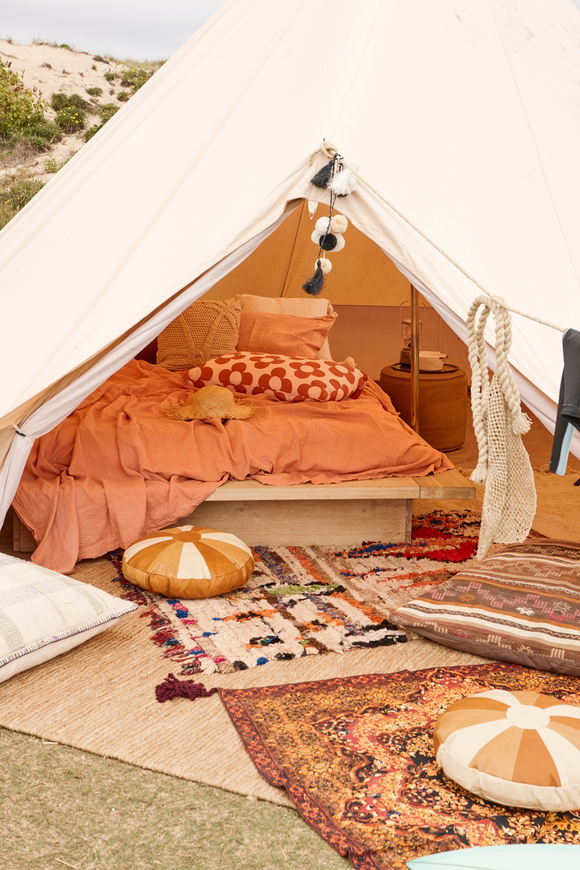 Colourful rugs and floor cushions will add colour and style while cosying up your glamping setup.