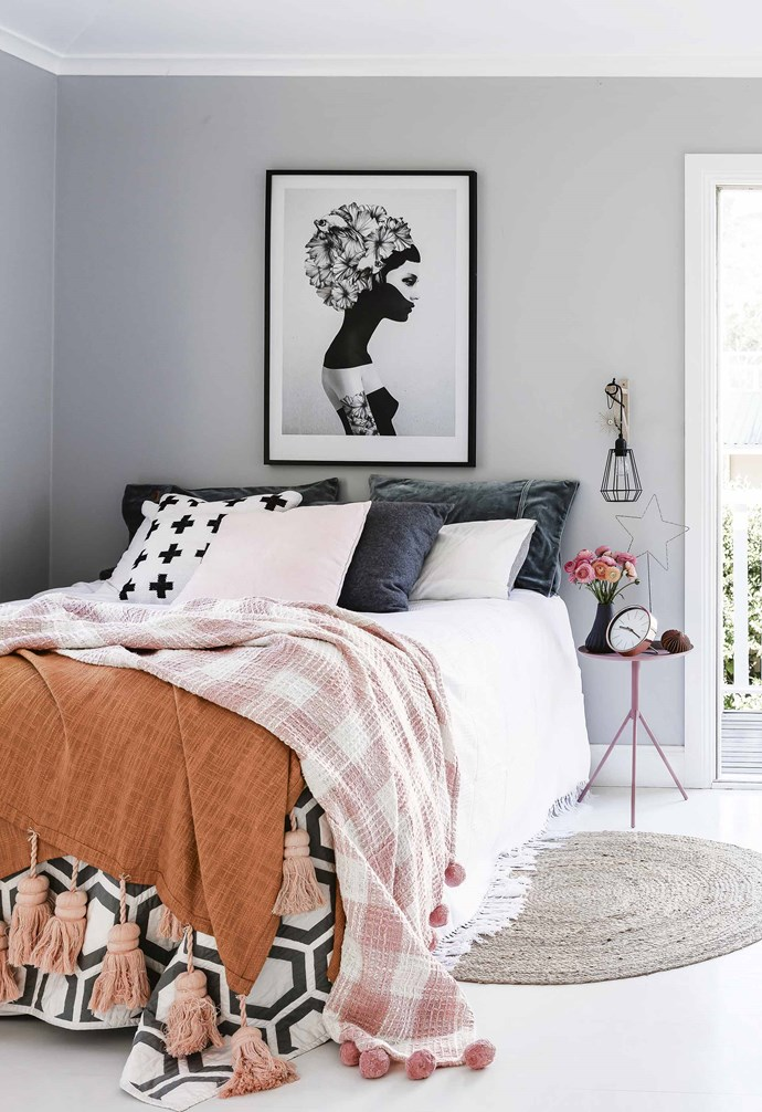 """**Pop of colour** The muted grey walls in this cosy bedroom add a soft contrast to the stark white flooring, ceiling and trim, creating an easy-on-the-eyes palette. Vibrant coloured and patterned bedding adds a playful pop of colour and personality in this [rustic coastal family home](https://www.homestolove.com.au/design-ideas-from-a-coastal-meets-rustic-family-home-17691 target=""""_blank""""). *Styling: Vanessa Colyer Tay   Photography: Maree Homer*."""