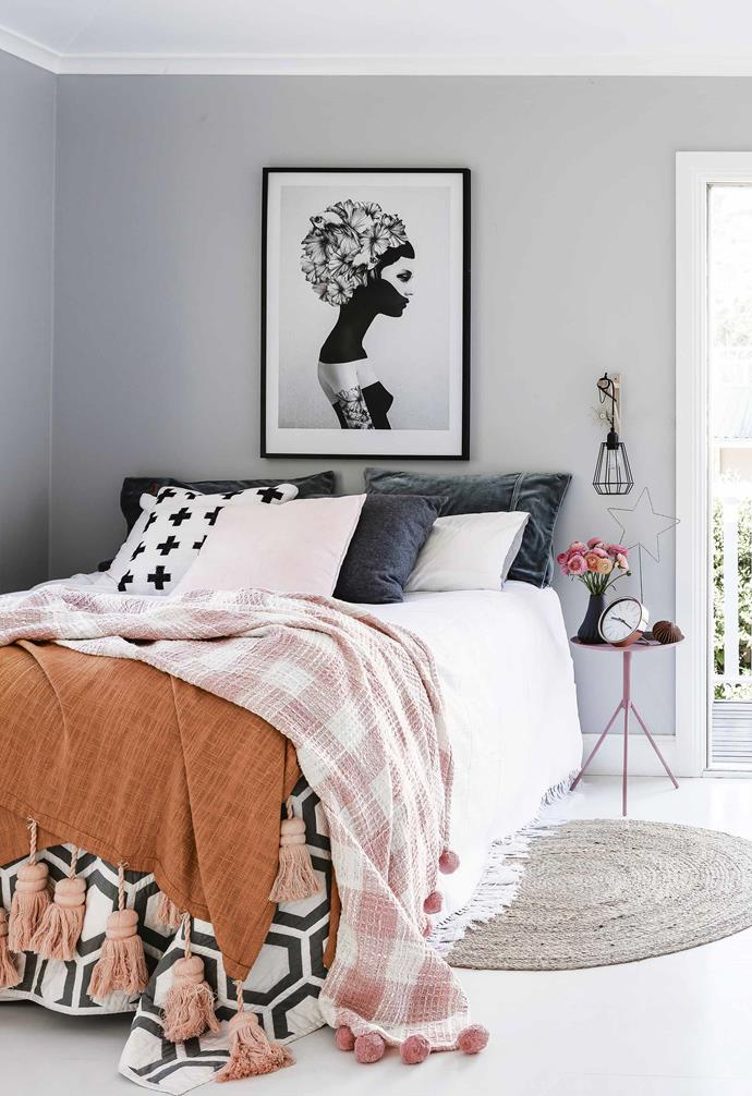 "**Pop of colour** The muted grey walls in this cosy bedroom add a soft contrast to the stark white flooring, ceiling and trim, creating an easy-on-the-eyes palette. Vibrant coloured and patterned bedding adds a playful pop of colour and personality in this [rustic coastal family home](https://www.homestolove.com.au/design-ideas-from-a-coastal-meets-rustic-family-home-17691|target=""_blank""). *Styling: Vanessa Colyer Tay 