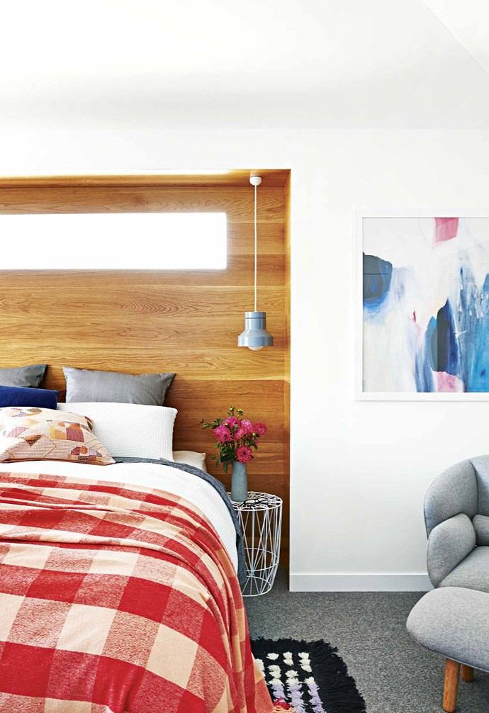 """**Bedhead twist** In this [family-friendly Californian bungalow](https://www.homestolove.com.au/family-friendly-californian-bungalow-18198 target=""""_blank"""") the traditional bed head has been inverted, with the bed nestling in an inset wall cavity that is lined in American oak. A narrow window in the nook adds visual interest to the space and allows natural light into the home. *Styling: Emma O'Meara   Photography: Nikole Ramsay*."""