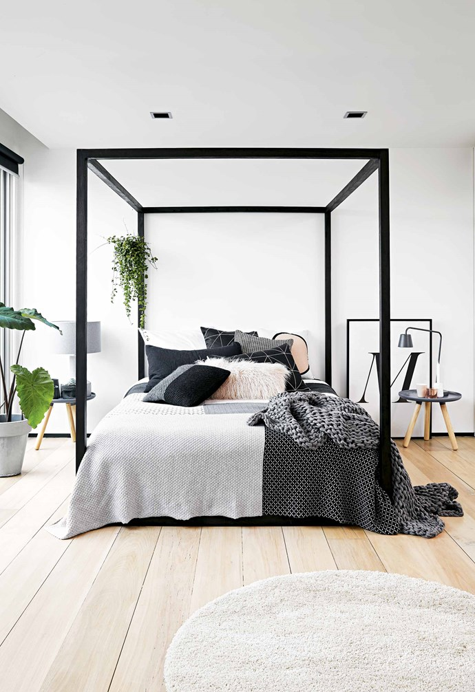 """**Frame it** A black and white monochrome colour palette runs throughout this [renovated warehouse apartment](https://www.homestolove.com.au/a-bright-and-inviting-three-storey-warehouse-apartment-18187 target=""""_blank"""") and the bedroom with its striking black canopy bed is no exception. *Styling: Deb McLean   Photography: Colin Doswell*."""