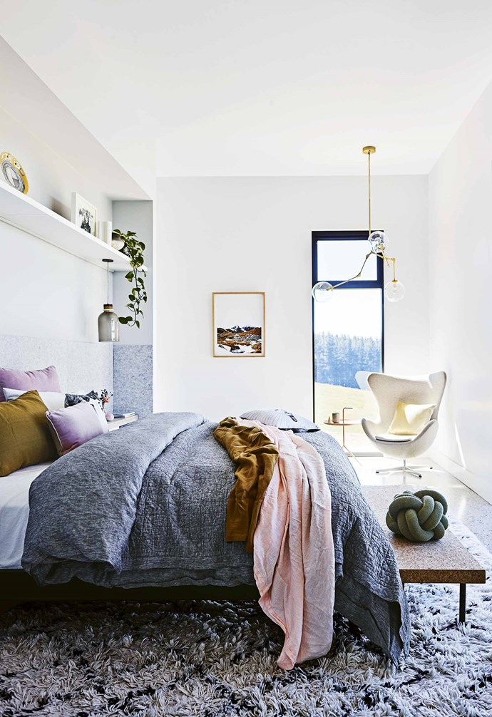 """**Tactile finish** Acoustic panels from Bunnings behind the bed lend a cosy feel in this [modern country farmhouse](https://www.homestolove.com.au/step-inside-this-cosy-country-farmhouse-with-modern-interiors-17468 target=""""_blank""""), and an in-built floating shelf above the bed adds additional storage to the bedroom. *Styling: Jono Fleming   Photography: Anson Smart*."""