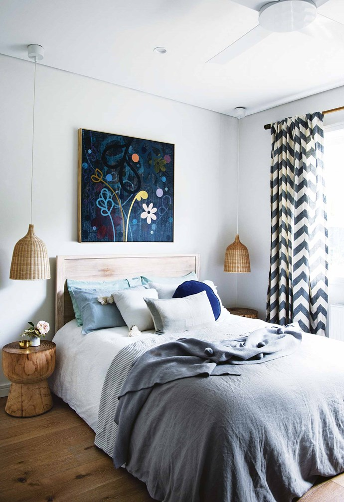 """**Pattern play** The relaxed styling in the bedroom of this [eco-friendly weatherboard house](https://www.homestolove.com.au/eco-friendly-weatherboard-house-freshwater-17440 target=""""_blank"""") is paired with a semi-sheer patterned curtain that adds a playful element to this space. *Styling: Vanessa Colyer Tay   Photography: Brigid Arnott*."""