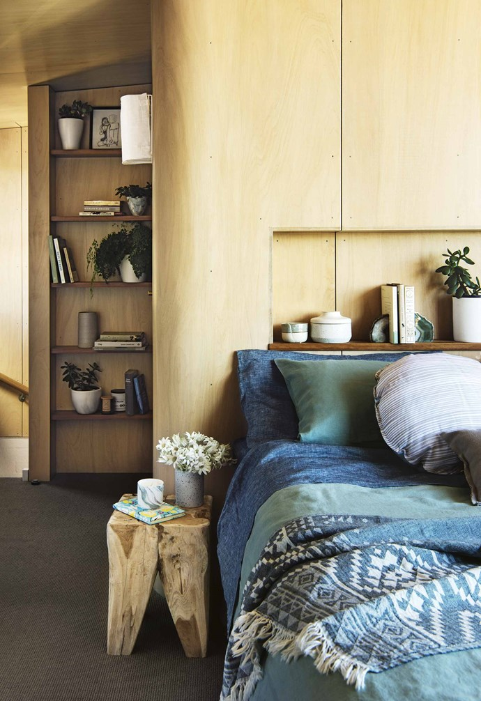 """**Playful plywood** This [beachside home](https://www.homestolove.com.au/how-to-bring-coastal-textures-into-the-home-18270 target=""""_blank"""" rel=""""nofollow"""") features a rich material palette to create a relaxed coastal aesthetic. In the bedroom the walls are lined with plywood and features open shelving for additional display and storage space. A clever nook in wall behind the bed takes the place of a bedhead. *Styling: Kerrie-Ann Jones   Photography: Brigid Arnott*."""