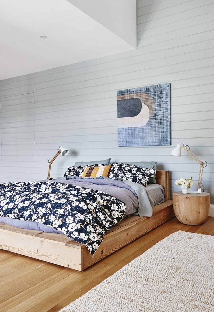 """**Panelled perfection** The master bedroom in this [renovated Barwon Heads Californian bungalow](https://www.homestolove.com.au/californian-bungalow-barwon-heads-17909 target=""""_blank"""") features panelled walls that are painted in a soothing soft grey, creating a sophisticated retreat from the rest of the vibrant home. *Styling: Emma O'Meara   Photography: Nikole Ramsay*."""