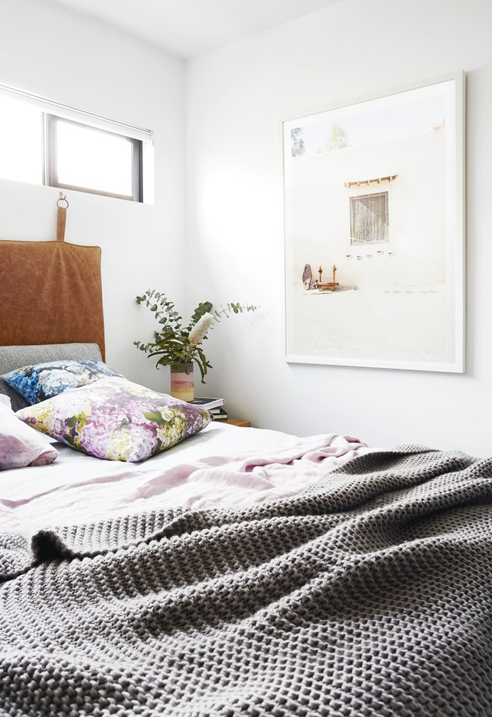 """**Hang it up** In compact homes there's a number of styling tricks that can help give the illusion of space. In this [coastal holiday home](https://www.homestolove.com.au/coastal-holiday-home-19311 target=""""_blank"""") a leather bedhead hangs from hooks on the wall, taking up minimal space and creating an interesting visual feature. *Styling: Julia Green   Photography: Armelle Habib*."""