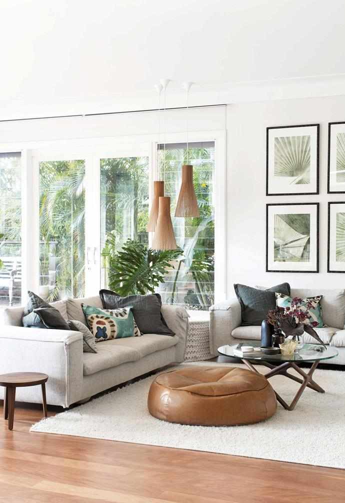 **Living room** The linen sofas, leather ottoman (both [Jardan](https://www.jardan.com.au/)), resin cocktail table ([Coco Republic](https://www.cocorepublic.com.au/)), and felted-wool rug ([Tappeti Fine Handcrafted Rugs+Carpets](https://www.tappeti.com.au/)) deliver textural interest. Birch pendant lights from [Fred International](https://fredinternational.com.au/) and palm-leaf prints from [Designer Boys Collections](https://www.designerboyscollections.com/landing/) link the interior with the courtyard outside. The Triple X coffee table from [Spence & Lyda](https://www.spenceandlyda.com.au/) references the console in the entry.
