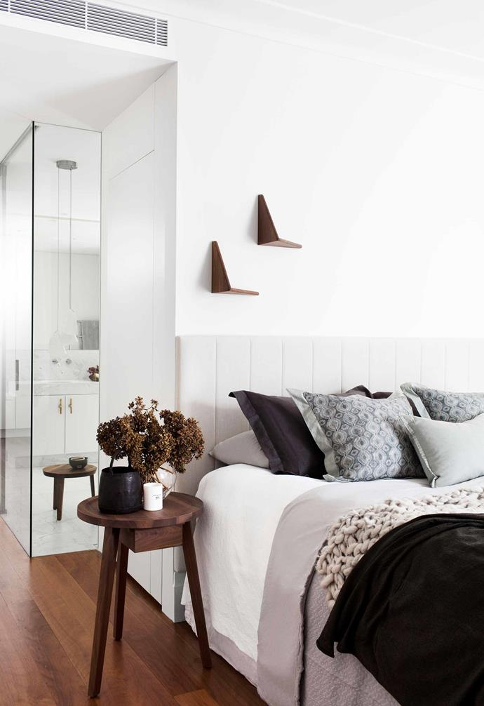 **Bedroom** Light and airy is the name of the game. A Gervasoni 'Gray 45' side table, used as a bedside, offers versatile (and moveable) storage, and glass panels allow glimpses of the luxe Bocci pendants from [Hub Furniture](http://www.hubfurniture.com.au/) in the ensuite. The upholstered headboard, designed by Hellen, echoes the ensuite's cabinetry. Paul Cadovius 'Butterfly' shelves from [Great Dane](https://greatdanefurniture.com/) complement the walnut tables.