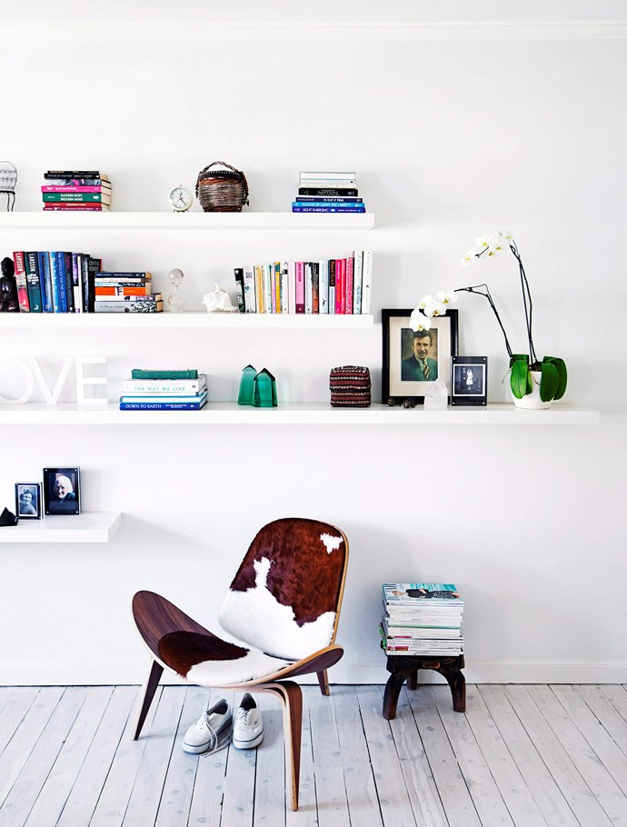 A designer armchair lined in cowhide pops against a white backdrop. *Photo:* Maree Homer