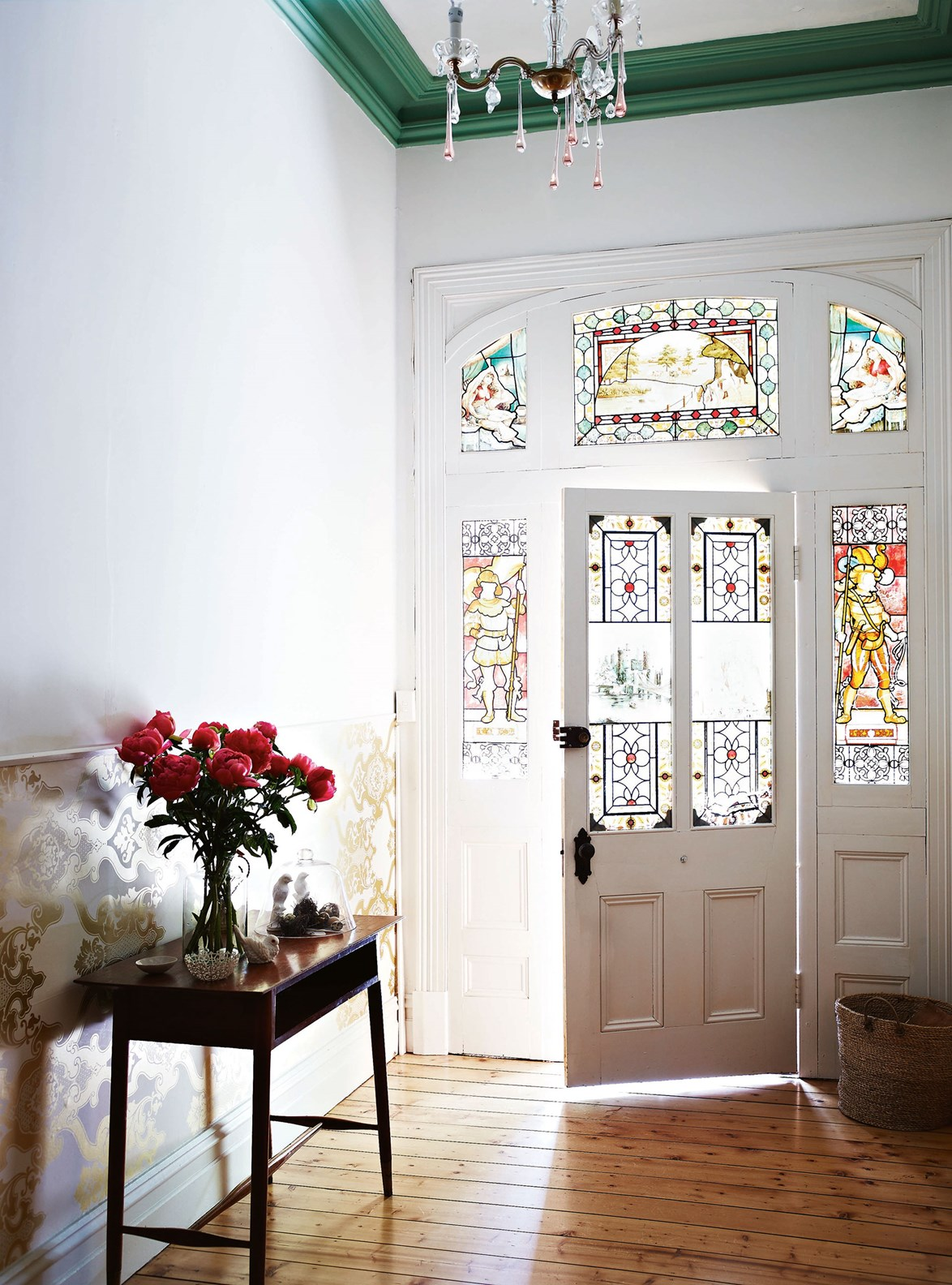 "With beautiful hand-painted windows framing the front door to this [historic Castlemaine cottage](https://www.homestolove.com.au/castlemaine-cottage-vintage-style-13814|target=""_blank""), styling is kept simple and cohesive with the vintage interiors."