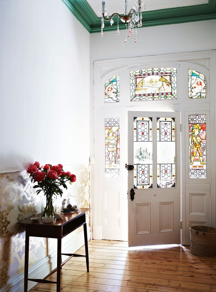 """Windows and doors in home's entryway have beautiful [handpainted glass panels](https://www.homestolove.com.au/stained-glass-19272 target=""""_blank"""") — one that survives in a side entrance depicts Edinburgh Castle in Scotland, another a misty waterfall scene in a distant place far from the often hot and dry Castlemaine."""
