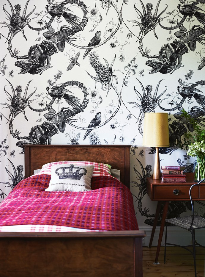 """[Timorous Beasties](https://www.timorousbeasties.com/ target=""""_blank"""" rel=""""nofollow"""") 'Iguana' wallpaper features in Fletcher's bedroom, the lamp and desk were eBay finds and the bed was Suzi's grandparents."""