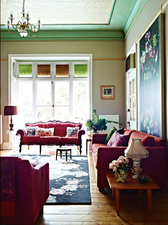 """Although it had undergone a few changes over the years, from ceilings lowered to laminate attached to interior walls, Dudleigh had been restored to good condition. In some rooms, cornices and ceilings were already picked out in deep turquoise. Suzi left them intact, as her """"[London aesthetic](https://www.homestolove.com.au/an-interior-designers-guide-to-london-6647 target=""""_blank"""")"""" includes an appreciation of colour in interiors. """"I love that whole colour thing, although  this house is very subdued compared to my last one."""" A rococo sofa from Suzi's former store sits in the drawing room bay window beside a 1960s lamp made by inmates of the former Castlemaine Prison."""