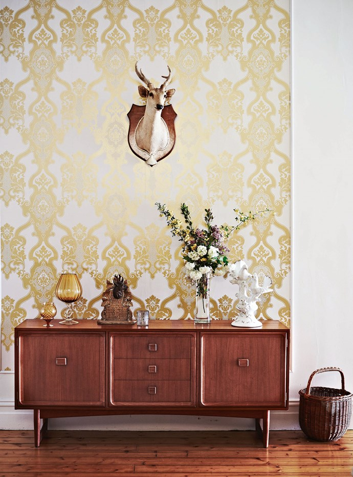 """Suzi's [eclectic style](https://www.homestolove.com.au/colourful-eclectic-style-apartment-19184 target=""""_blank"""") embraces several eras but her collections fit surprisingly well within the old house. """"I love the 1960s, but I also love the 1760s and 1860s,"""" she says with a laugh. She brings together 1960s Swedish furniture and glassware, combining them with family heirlooms, taxidermy and Capodimonte china, at times aware she's testing the boundaries even of her own taste."""