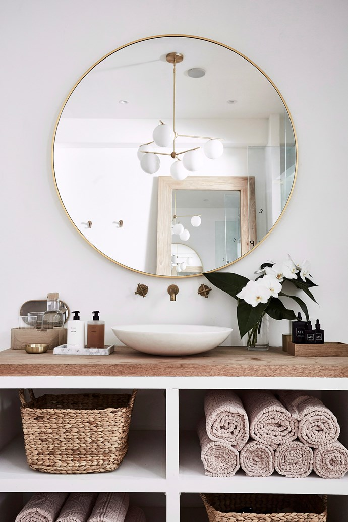 Create a spa-like feel in your bathroom with fresh flowers, candles, soaps and hand creams on display. *Photo:* Kristina Soljo / *bauersyndication.com.au*