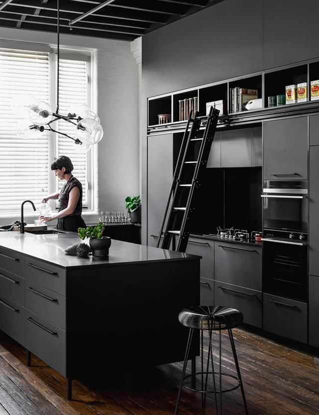 "An island bench in a beautiful Bengal Black honed granite is at the centre of this bold kitchen in a [warehouse conversion in Brisbane](https://www.homestolove.com.au/historic-warehouse-turned-industrial-apartment-19973|target=""_blank"")). *Photograph*: Cathy Schulser 
