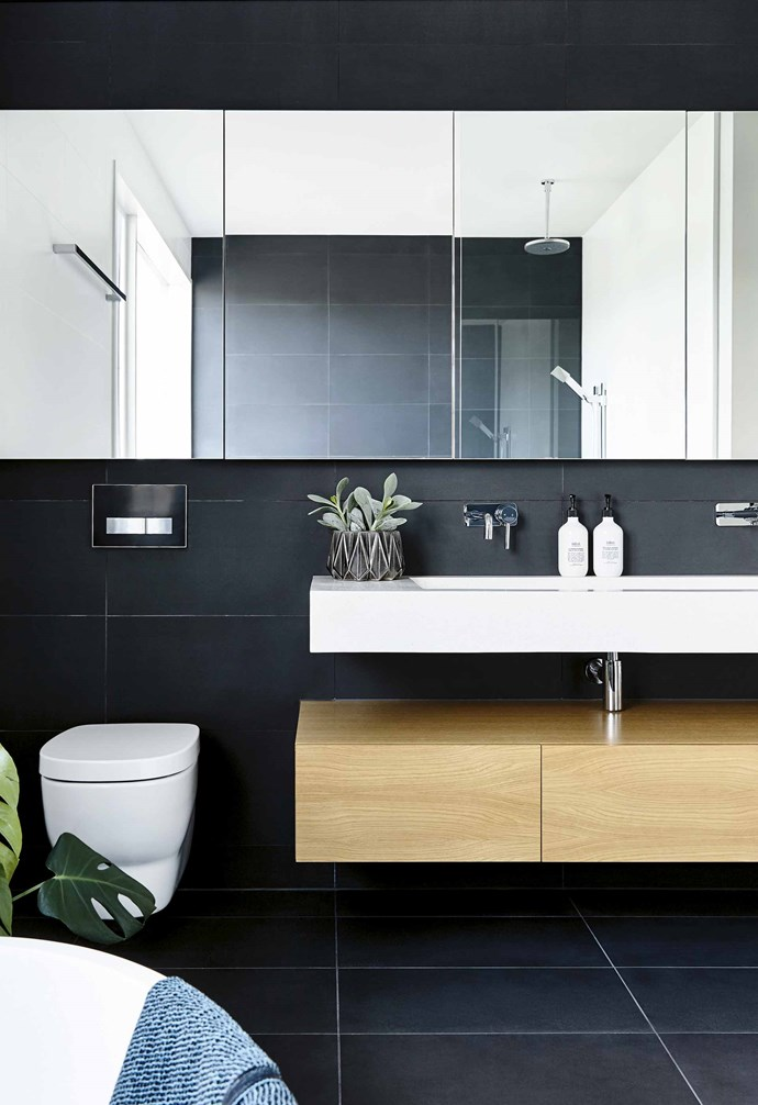 "Floating shelves and a wall-mounted toilet were chosen to keep the floor clear in this stunning home. *Design: [Inform Design](https://informdesign.com.au/|target=""_blank""