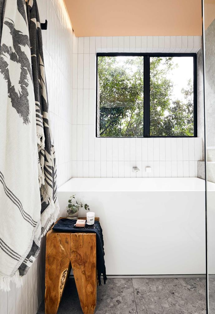 "In Shannon's own [tiny apartment bathroom renovation](https://www.homestolove.com.au/apartment-bathroom-renovation-19596|target=""_blank"") narrow elongated subway tiles lay vertically on the walls, adding to the illusion of height. *Design: Shannon Vos 