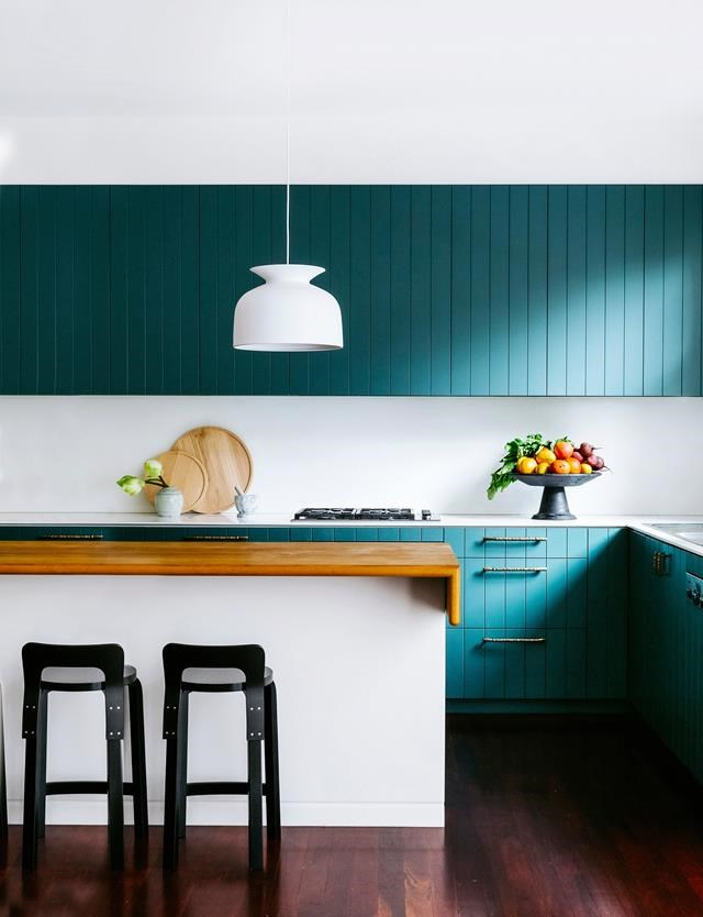 "A moody teal was applied to the joinery in this [California bungalow kitchen](https://www.homestolove.com.au/colourful-california-bungalow-by-arent-and-pyke-4946|target=""_blank""). The tallowwood-topped island bench is a favourite gathering place for the owners. *Photograph*: 