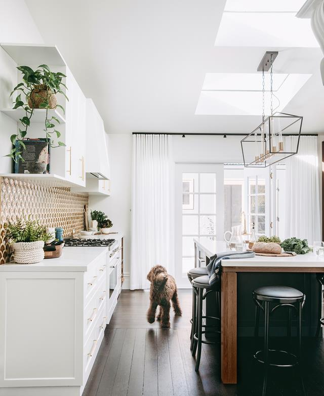 "Increased light and height transformed this dated kitchen into a [warm and functional space](https://www.homestolove.com.au/a-modern-kitchen-with-a-heritage-feel-18989|target=""_blank""). *Photograph*: Anjie Bair"