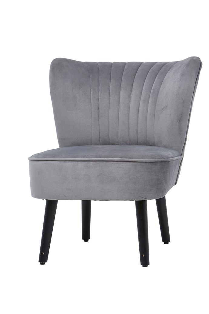Velvet slipper **armchair**, available in emerald and grey, $99.