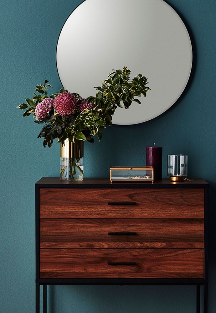 Big W's latest collection features a mix of retro inspired furniture and homewares. Here the **round mirror** in black, $19, hangs above the 'Heathrow' **sideboard**, $39.