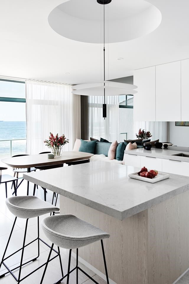 "The owners of this [beachside townhouse](https://www.homestolove.com.au/a-modern-beach-house-kitchen-6381|target=""_blank"") in Newcastle called local interior designer Stewart Horton to help them redesign their dated kitchen to create an open plan entertaining zone. *Photograph*: Alexander McIntyre"