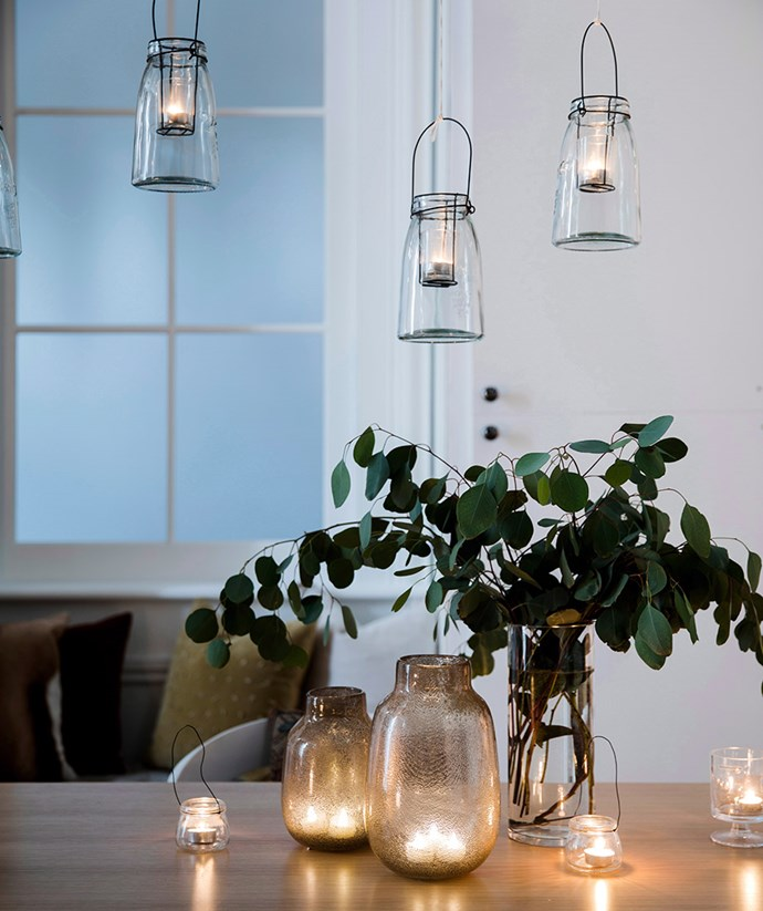 A combination of hanging lanterns and tea-light candles bring warmth and ambience to this dining room setting. *Image: Chris Warnes / bauersyndication.com.au*