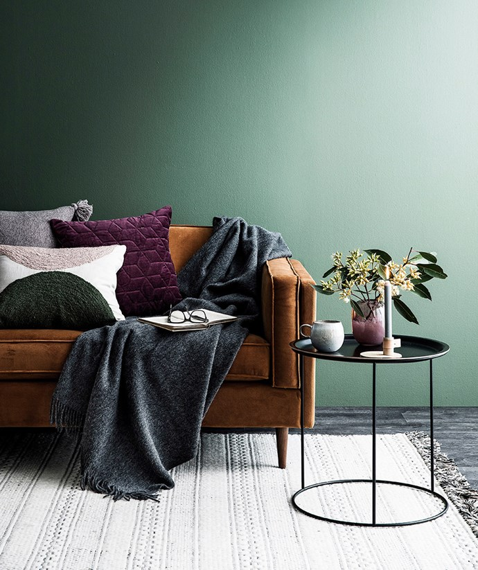 A cashmere throw-over and velvet cushions in rich tones combine to create the perfect lounging zone for a cold winters night. *Image: Maree Homer / bauersyndication.com.au*