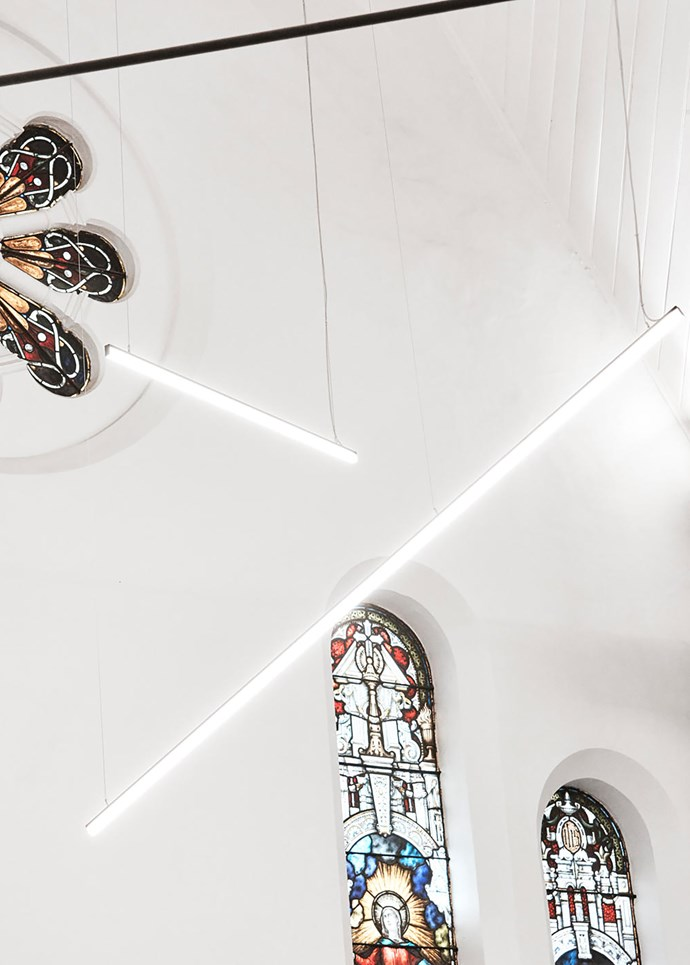 Bespoke light by Lucifero's Archi-Tech Lighting and the original 18th-century stained-glass windows.