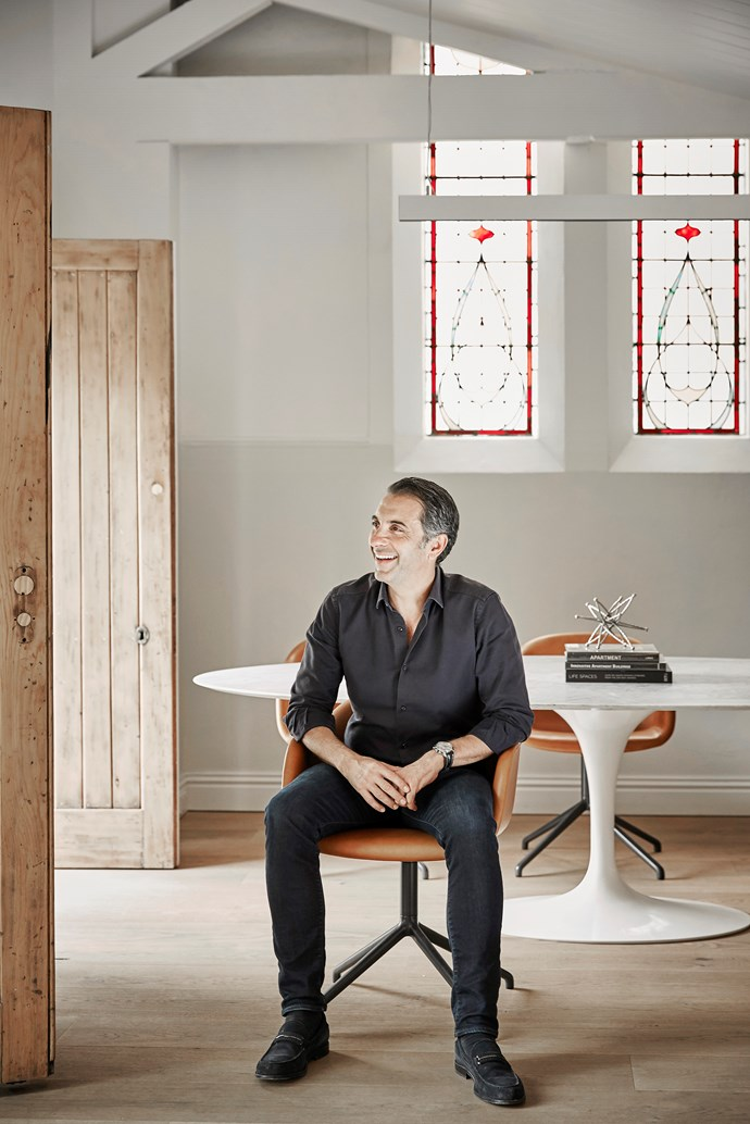 Vince Squillace sits on a Muuto 'Fiber' armchair by a Knoll Saarinen 'Tulip' table.