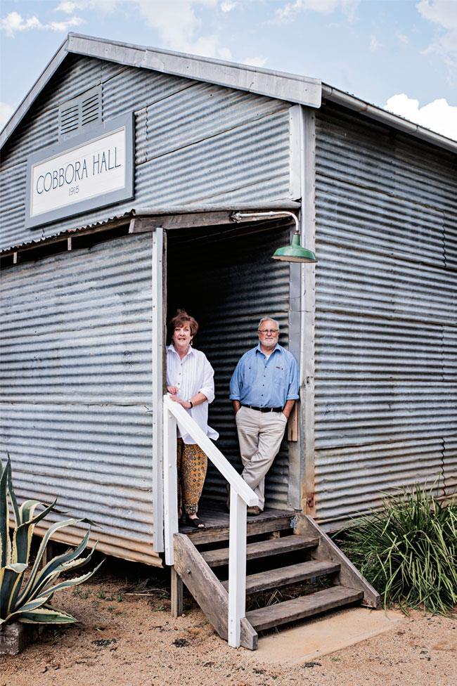 """Rob Ingram (left) with his wife Penny Stevens at Cobbora Hall in Dunedoo. The pair restored the historic hall and it once again serves the community as an event space for weddings, parties and events. *Photo: [Cobbora Hall](http://www.cobborahall.com.au