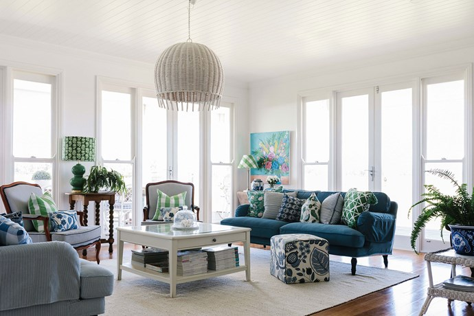 The sitting room is a pretty mix of colourful fabrics and natural materials, such as the cane pendant from St Barts.